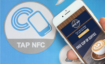 Smartphone touching NFC tag with a Digital Coupon on the smartphone.