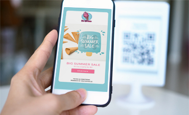 Customer scans QR Code and a Digital Coupon automatically opens on the smartphone.