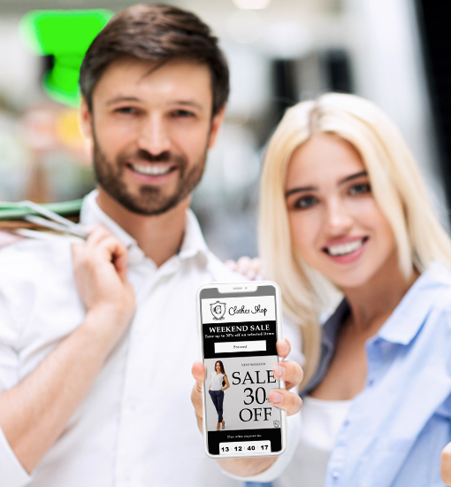 Happy people holding smartphone with Digital Clothing Coupon for shopping centers.